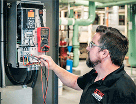Technician working on an HVAC Control